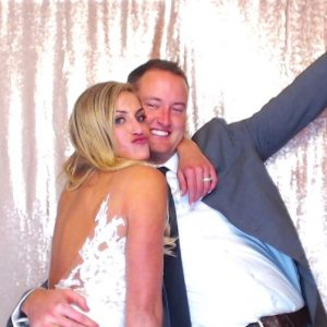 The bride and groom using the open air photo booth during their wedding reception at The Manor House