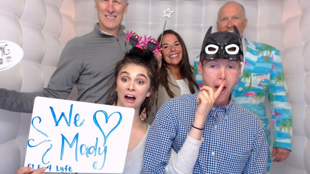 Grad party guests using the photo booth